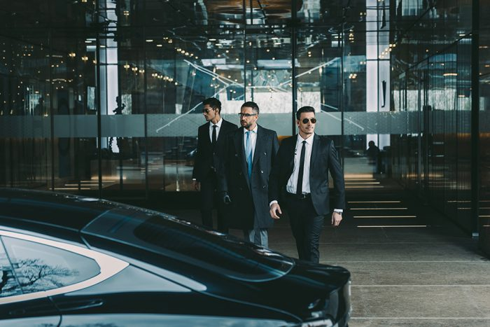 Bodyguards with businessman
